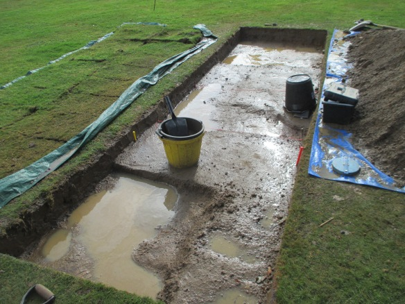 A very wet trench. the different colours of the layers showed up well after a drenching!
