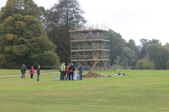 The storms across the south lawn kept blowing the table over so we weighted the legs with a shovel and mattock and Matt talked through the layers of historic gardens with the drawings in a vertical position.
