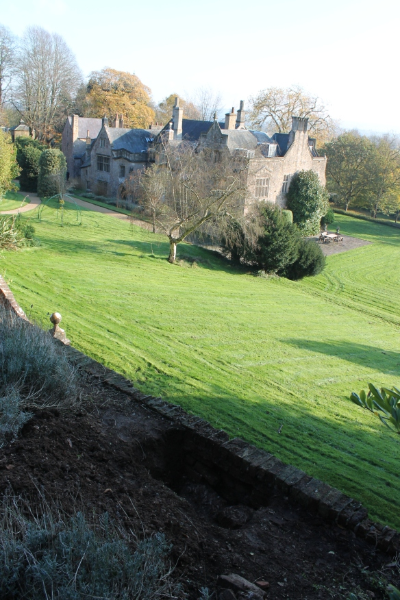 Looking back on Clevedon Court from the evaluation trench dug to discover why the brick garden wall was collapsing. The wall had not been tied in to the earlier stone wall behind it.