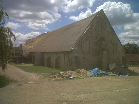 The tithe barn at Court Place Farm beside the new NT office at Tisbury.