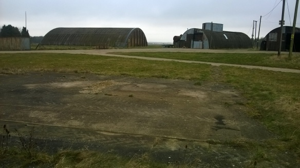 Three WWII blister hangers now used as farm buildings.