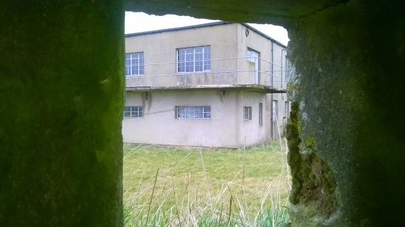 View of the Watch Office from the pill box which once guarded RAF Windrush.