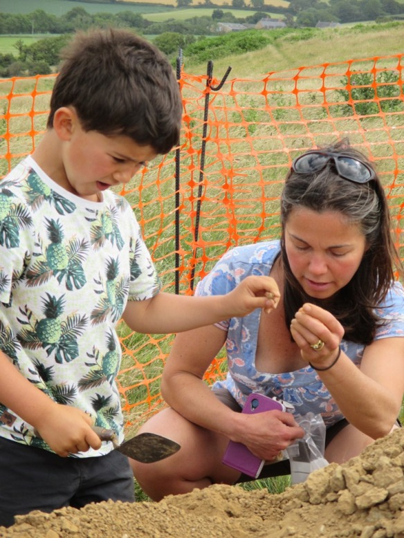 Robin and his Mum finding archaeological finds on the spoil heap