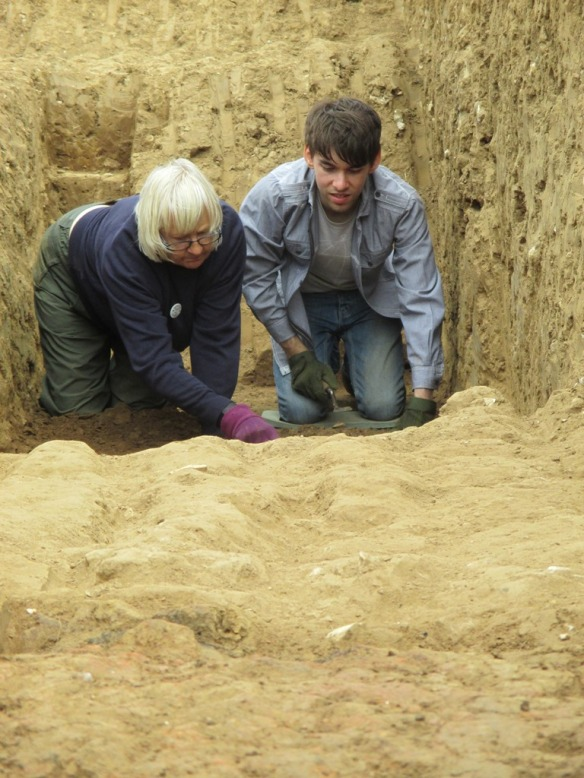 Millie and Mike excavating down to the mound