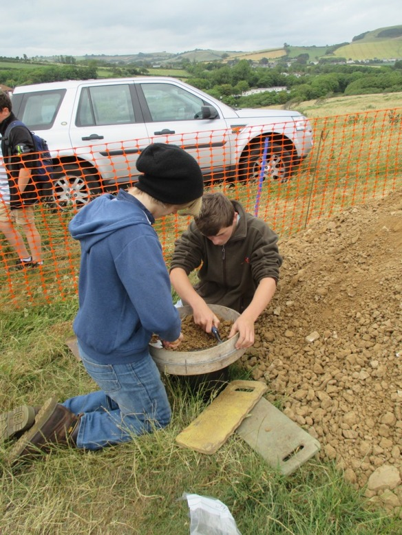 Sieving the mound soil