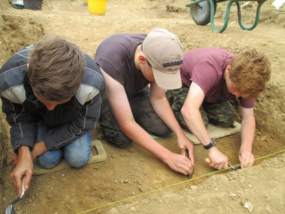 Students  excavating on site
