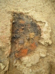 The clay layer removed and the pottery sherd is near the bright orange area