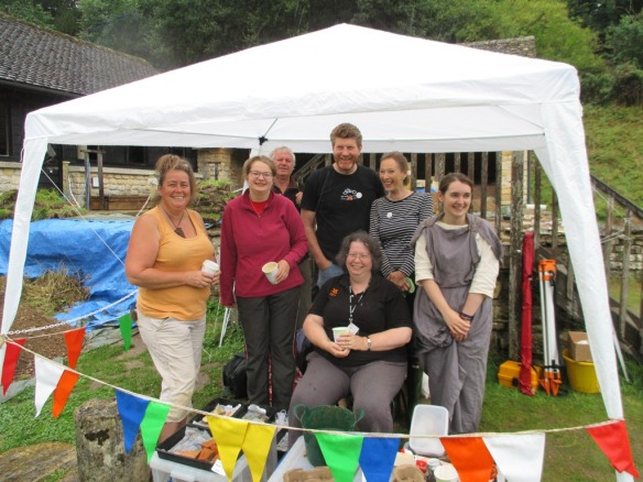 Thank goodness for the little gazebo, Sue in the middle with the finds she is washing in front of her.