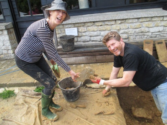 A very happy couple with the roof tile from trench A