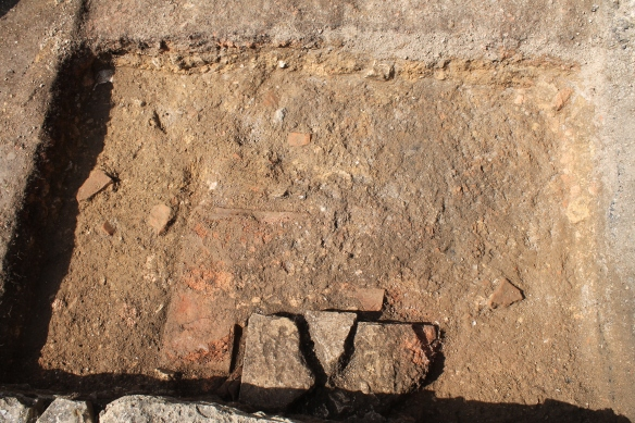The stone and tile structure in trench A