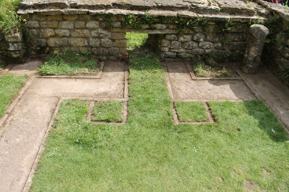 First day showing Sir Ian Richmond's interpretation in Room 24. The reddened walls below the concrete matched the alignments of his reconstruction of a 2nd century heating stoke hole except the kerbed grass squares in front which we could not relate to the buried archaeology.