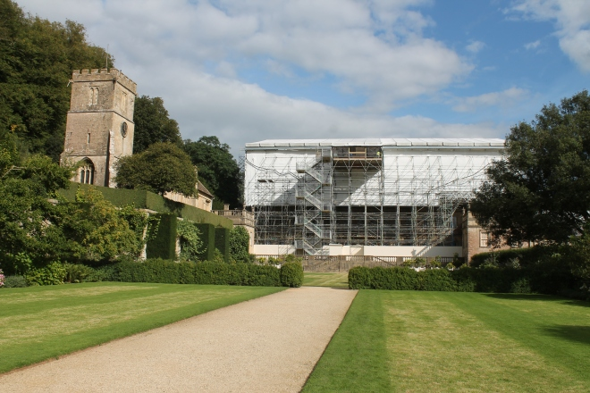 The west side of Dyrham House.Now covered in scaffolding while the roof is repaired. The medieval parish church beside it shows that there has been a house here at least since medieval times.