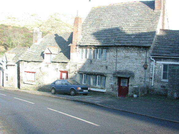 Uvedales House on East Street, Corfe Castle. The large windows have the letters IV and HV carved into the stone on either side. Henry Uvedale.
