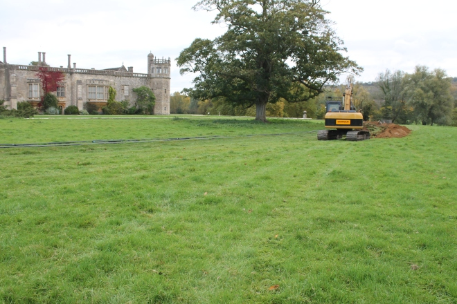 Lacock from the south west the trench skirting the parkland tree, the corner of the Tudor garden was just clipped by the trench before the pipeline continued round to the east skirting the 18th century bastion wall which separates Abbey and Park.