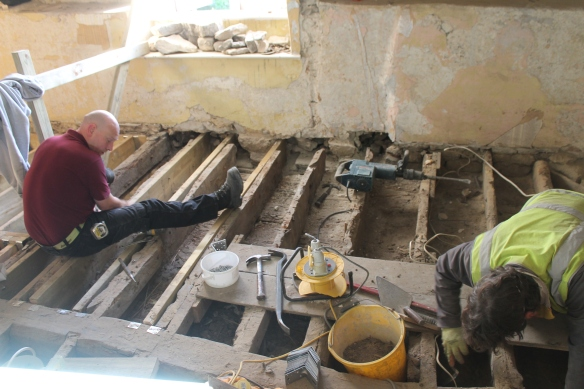 On the second floor, the spaces beween the joists were found to be filled with sand. Insulation? sound proofing? It had been there for at least 150 years it seems because the latest coin found in the sand was 1838.
