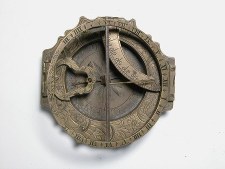 Engraved brass pocket compass and sundial with German inscription on the reverse the last letters reading 'And. Vogh'. Folding with a shaped outer rim. Part of the NT collection from Snowshill Manor Glos.
