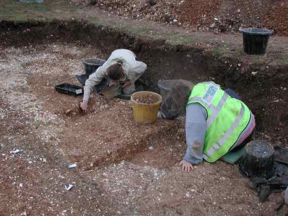 Excavating the ditch of a iron age round house, just inside the inner bank of Badbury Rings
