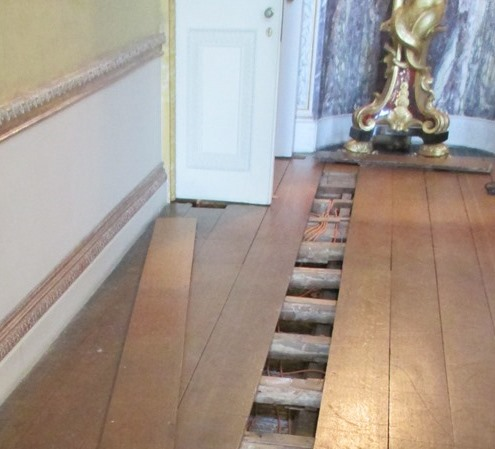 Floorboards lifted in the Saloon at Kingston Lacy