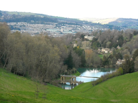 The view from the front o Ralph Allen's 18th century Neo-classical house looking north-west across is designed parkland landscape towards the city of Bath. The palladian bridge over the lakes can be seen in the middle distance