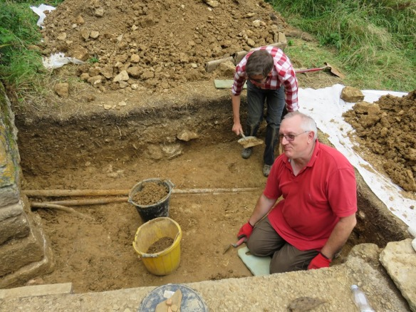 Les and Peter managing to work through the sticky clay, the lead pipe is the nearest pipe curving downwards