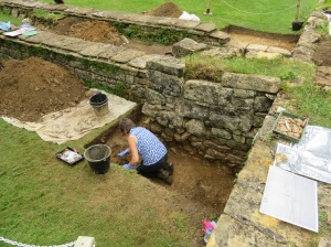 Eileen cleaning the last of the upper dark soil from the trench