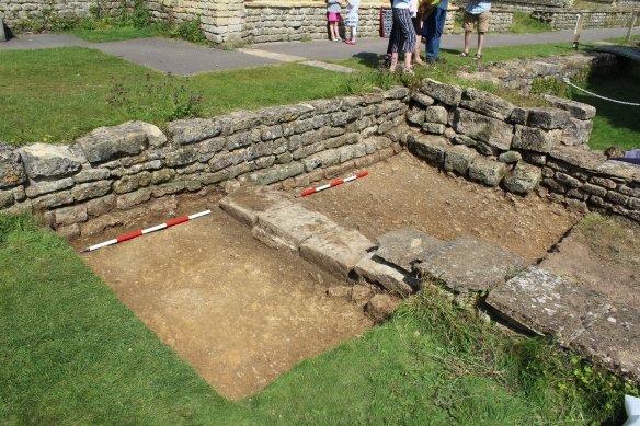 Looking north-east showing the two walls of the East Gallery butting onto the higher North Range reception room (we will uncover the mosaic, if it is still there, under the turf top left next week). The probable doorway into the courtyard bottom left. Mortar floor cut by foundation trenches bottom left. Thick buttress wall top tight.