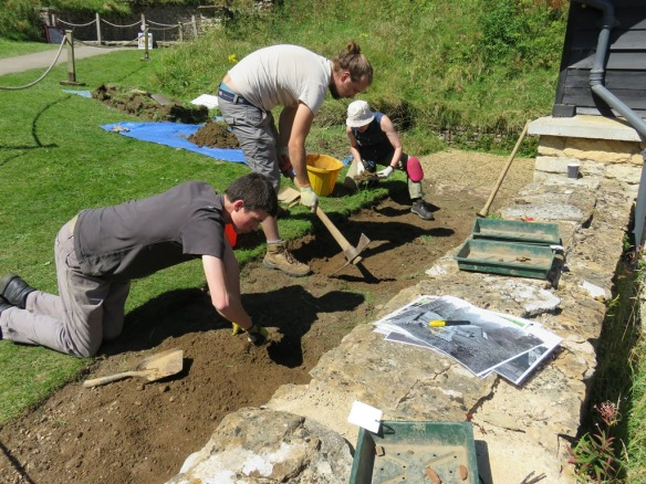 Alex, Seb and Carol cleaning back the top soil behind the bath house