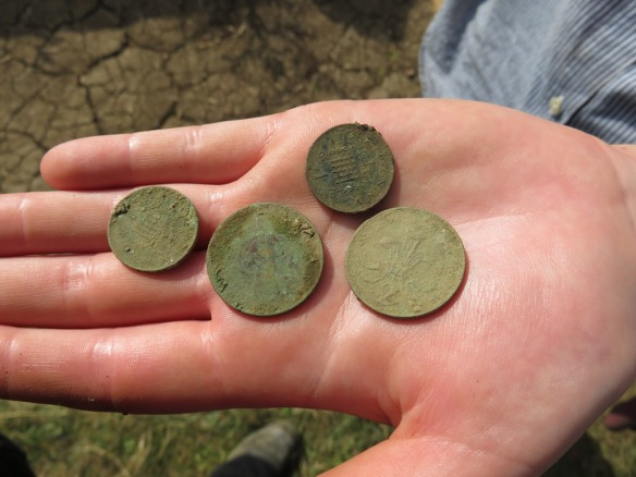 Modern coins from the top soil, not in very good condition to say they had not been buried long!