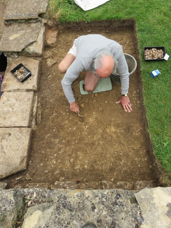 The original wall foundation trenches are in front of Tony and to his right