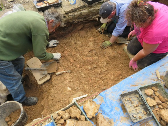 Rob, Fay and Allan trying to dig down but held up by numerous lumps of plaster and loose tesserae