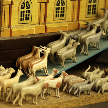 Close view of the wooden Noah's Ark with model animals made in the mid-C19th in the Black Forest area of Germany, collected by Charles Wade and displayed with other toys in Seventh Heaven, Snowshill Manor.