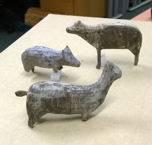 The wooden animals a pig, a Deer/Lama and a Sheep/?